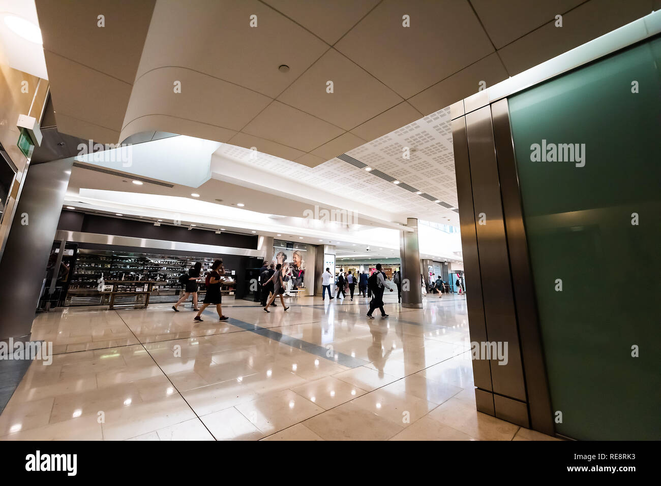 London, UK - June 26, 2018: Interior of modern shopping centre building in financial district in Canary Wharf Docklands architecture and people walkin - Stock Image