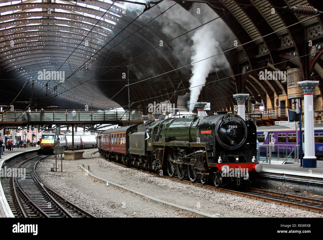 70013 Oliver Cromwell waits at York with the Scarborough Spa Express. - Stock Image
