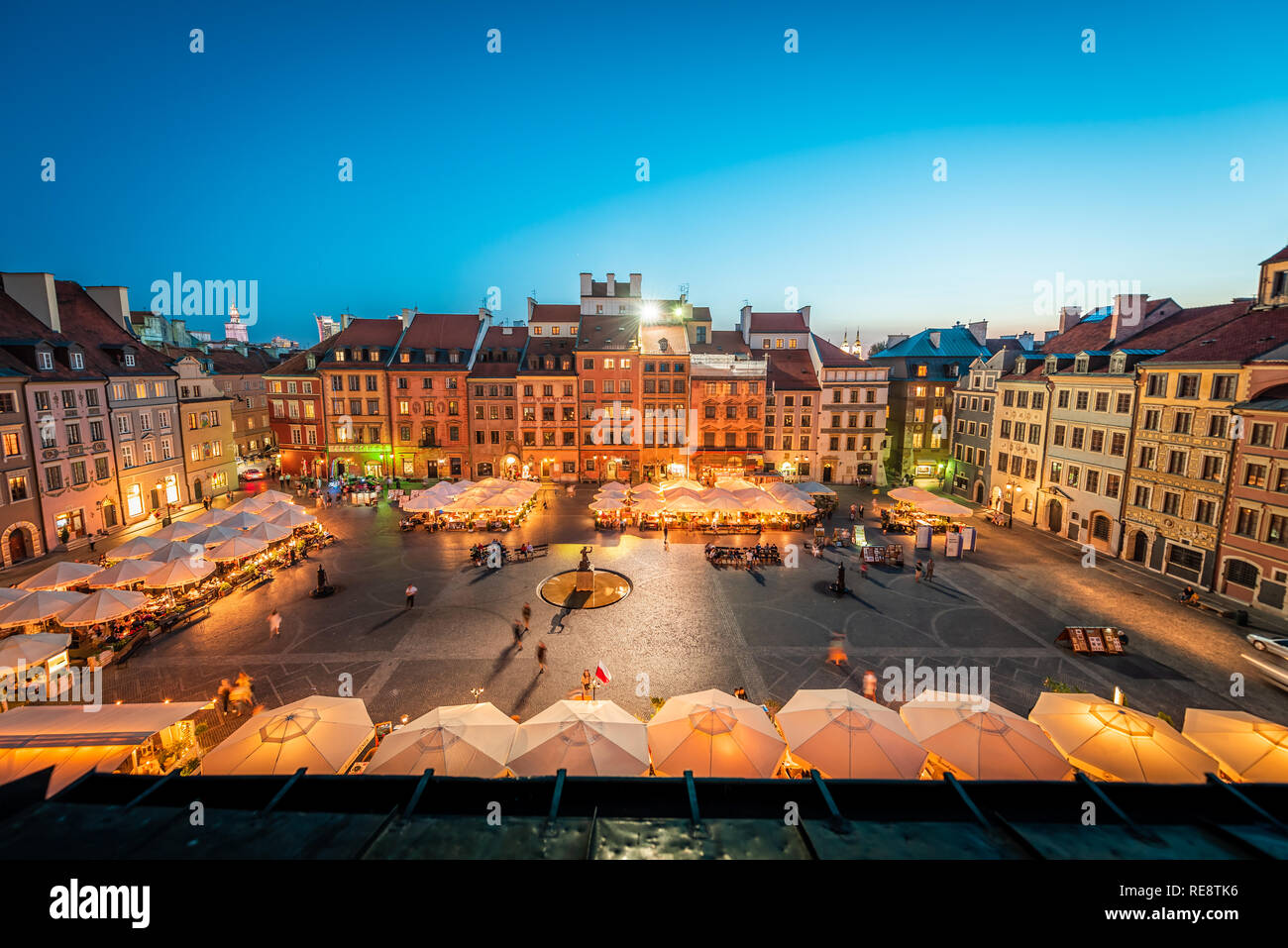 Warsaw, Poland - August 22, 2018: Historic cityscape with high angle view of architecture rooftop buildings and dark sky in old town market square at  Stock Photo