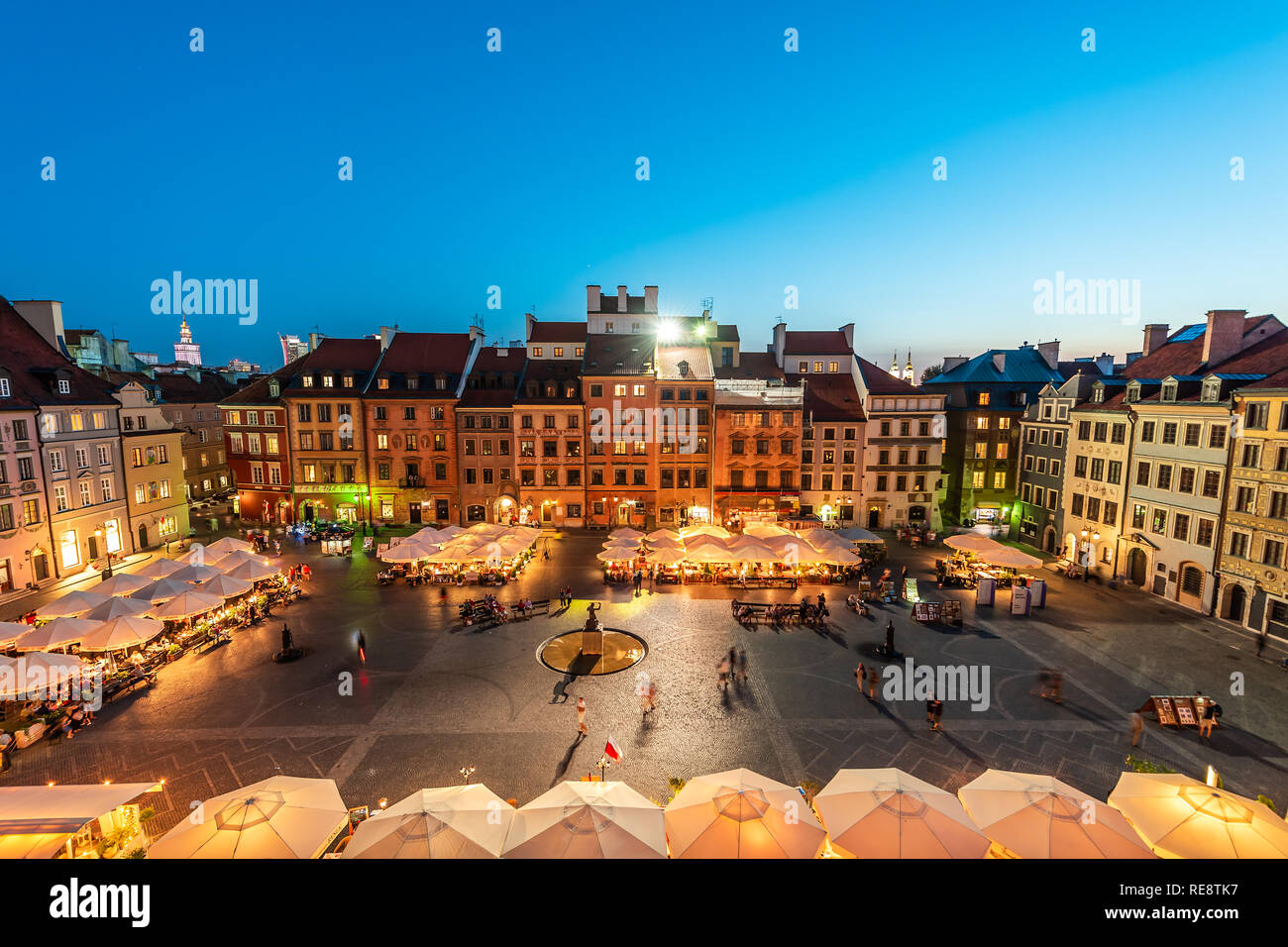 Warsaw, Poland - August 22, 2018: Cityscape with high angle view of architecture rooftop buildings and dark sky in old town market square at night Stock Photo