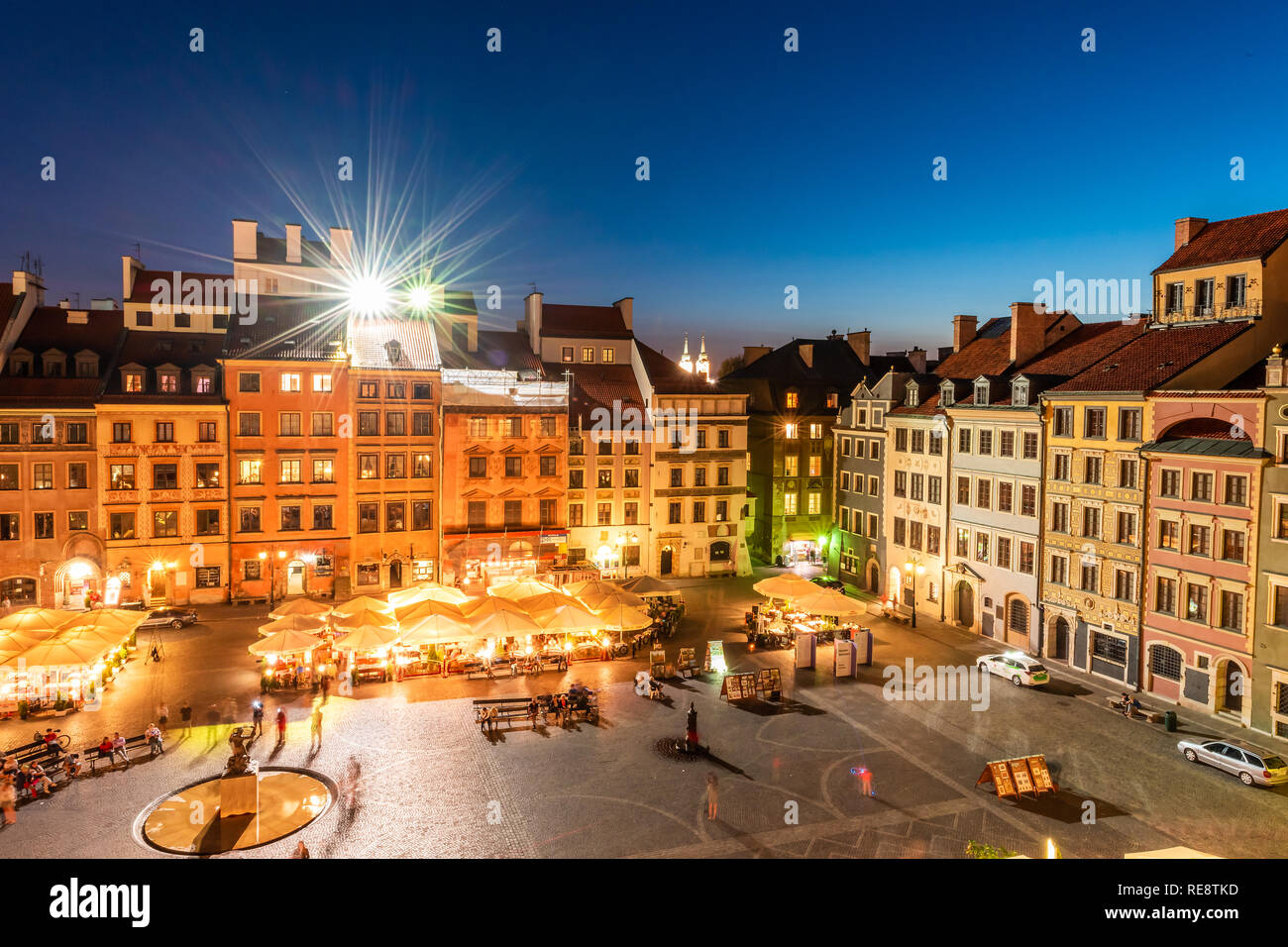 Warsaw, Poland - August 22, 2018: Cityscape with high angle view of architecture rooftop buildings restaurant and dark sky in old town market square a Stock Photo