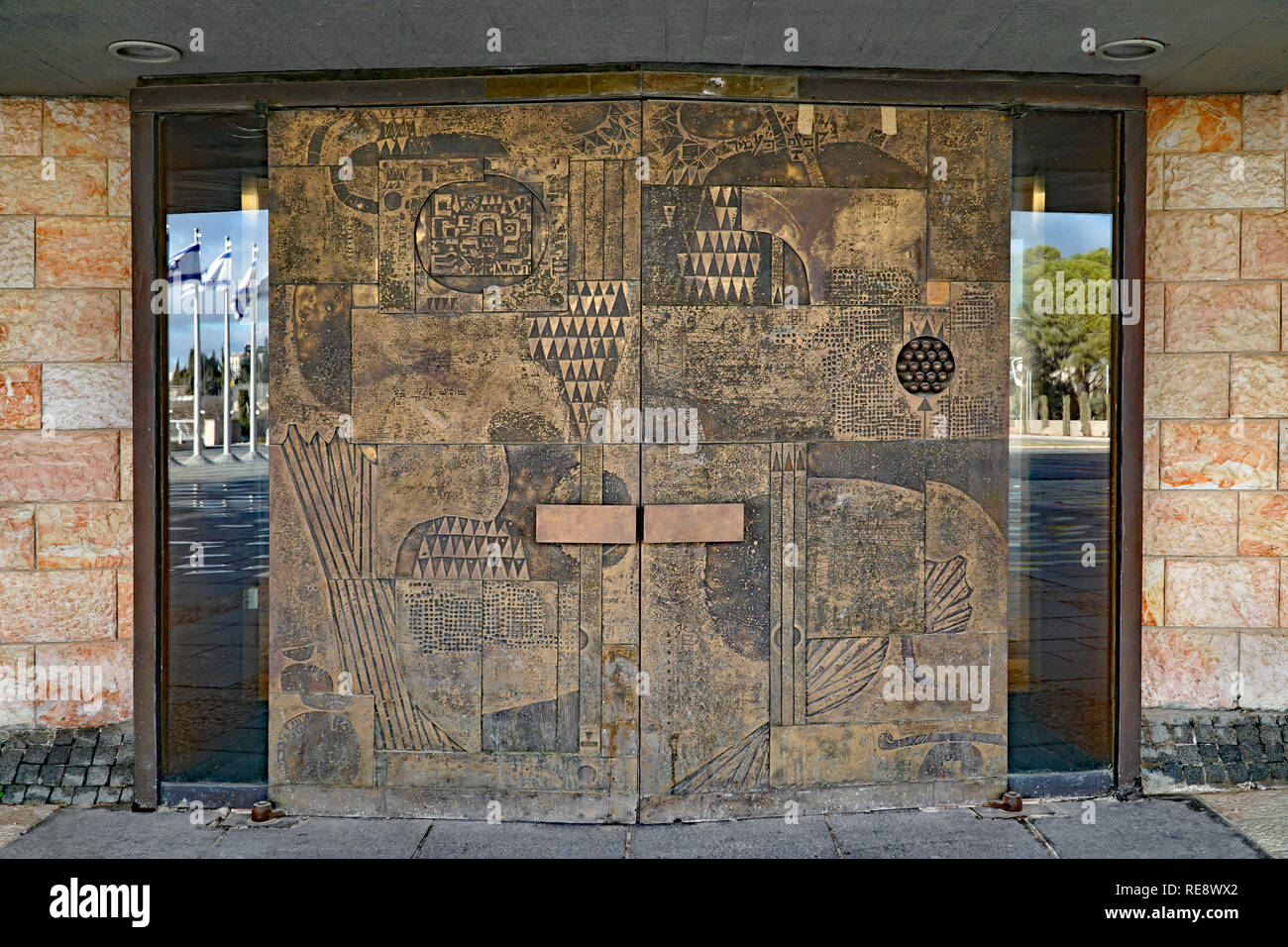 Copper covered doors of the Knesset building, Israel's parliament, with abstract designs representative of the ancient tribes - Stock Image