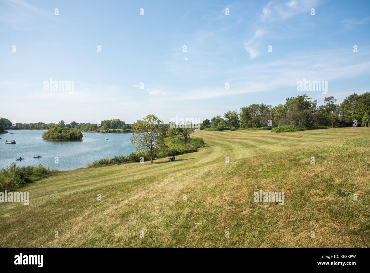 Naperville, Illinois, United States-September 4,2017:  Grass area, picnic table and boats at McDowell Grove Forest Preserve in Naperville, Illinois - Stock Image