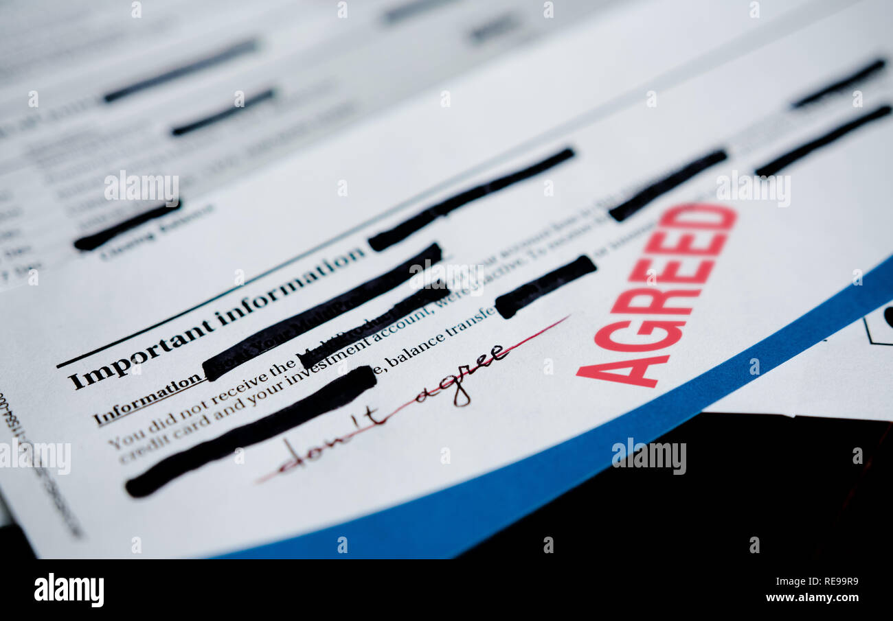 A under duress contract with redacted parts, falsely validated deed approved or agreed.. Stock Photo