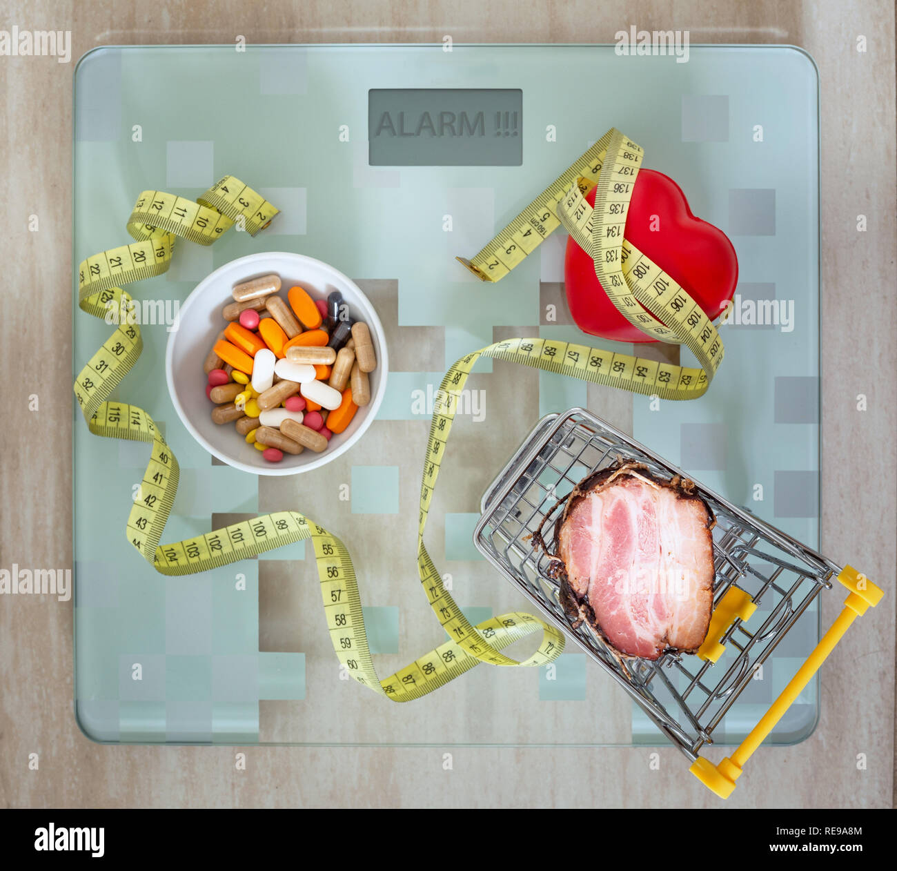Health. tablets, heart together with fatty food as a concept of overweight, poor nutrition or an incentive to a healthy lifestyl - Stock Image