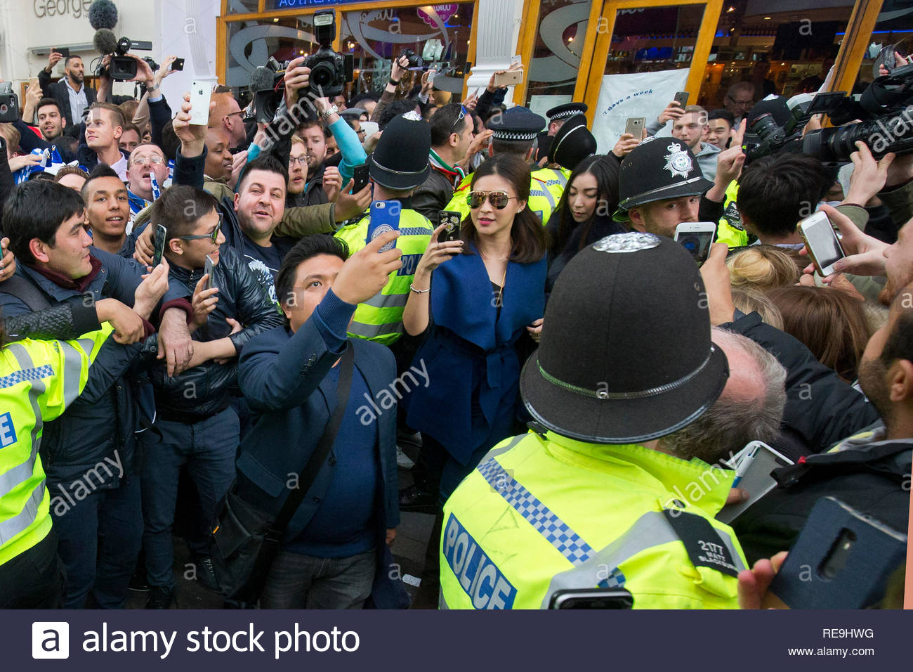 Nursara Suknama leaves a restaurant in Leicester City centre on 3rd May 2016 the day after Leicester City FC won the Premiere League title. - Stock Image