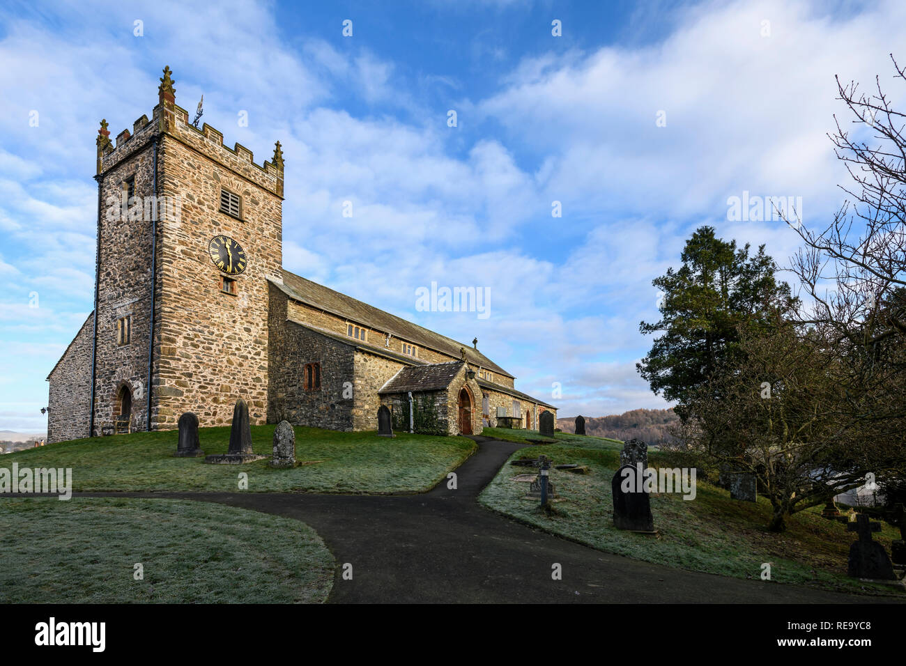 The imposing sight of St.Michael and All Angles church in Hawkshead - Stock Image