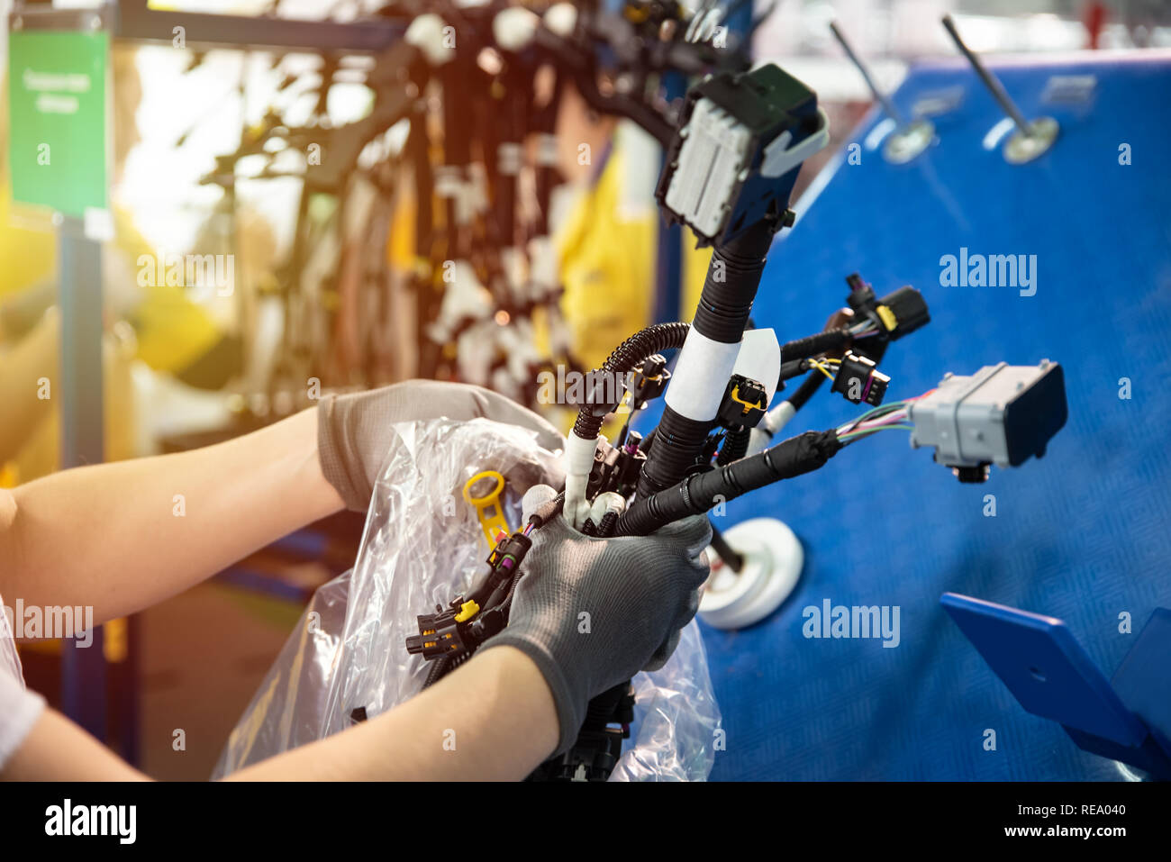 Stupendous Worker Is Packing A Wiring Harnesses Production Line Workflow Wiring Digital Resources Spoatbouhousnl