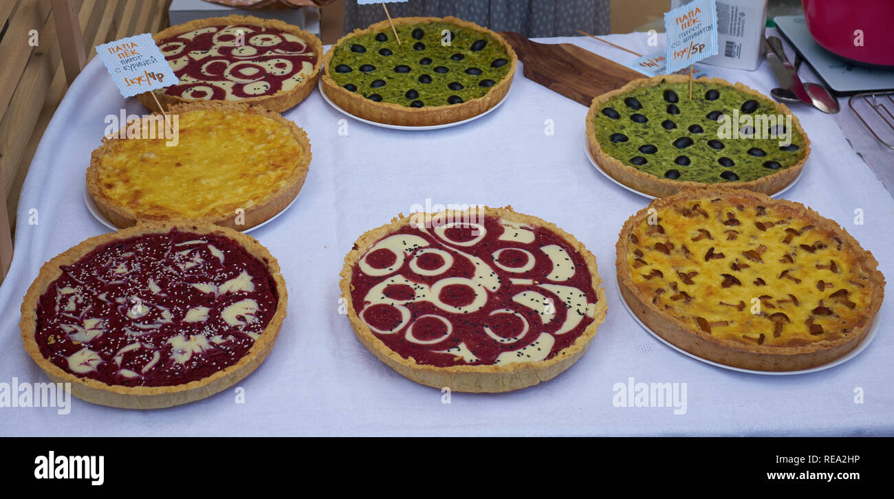 pies with mushrooms, olives, raspberry, tomato sauce, cheese on a table. Pizza ingredients. hot pies. Top view. copy space Stock Photo