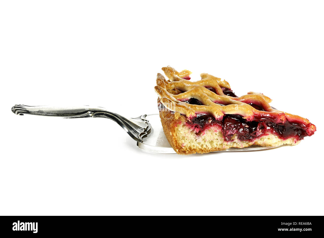 cake lifter with cherry cake wedge isolated on white background - Stock Image