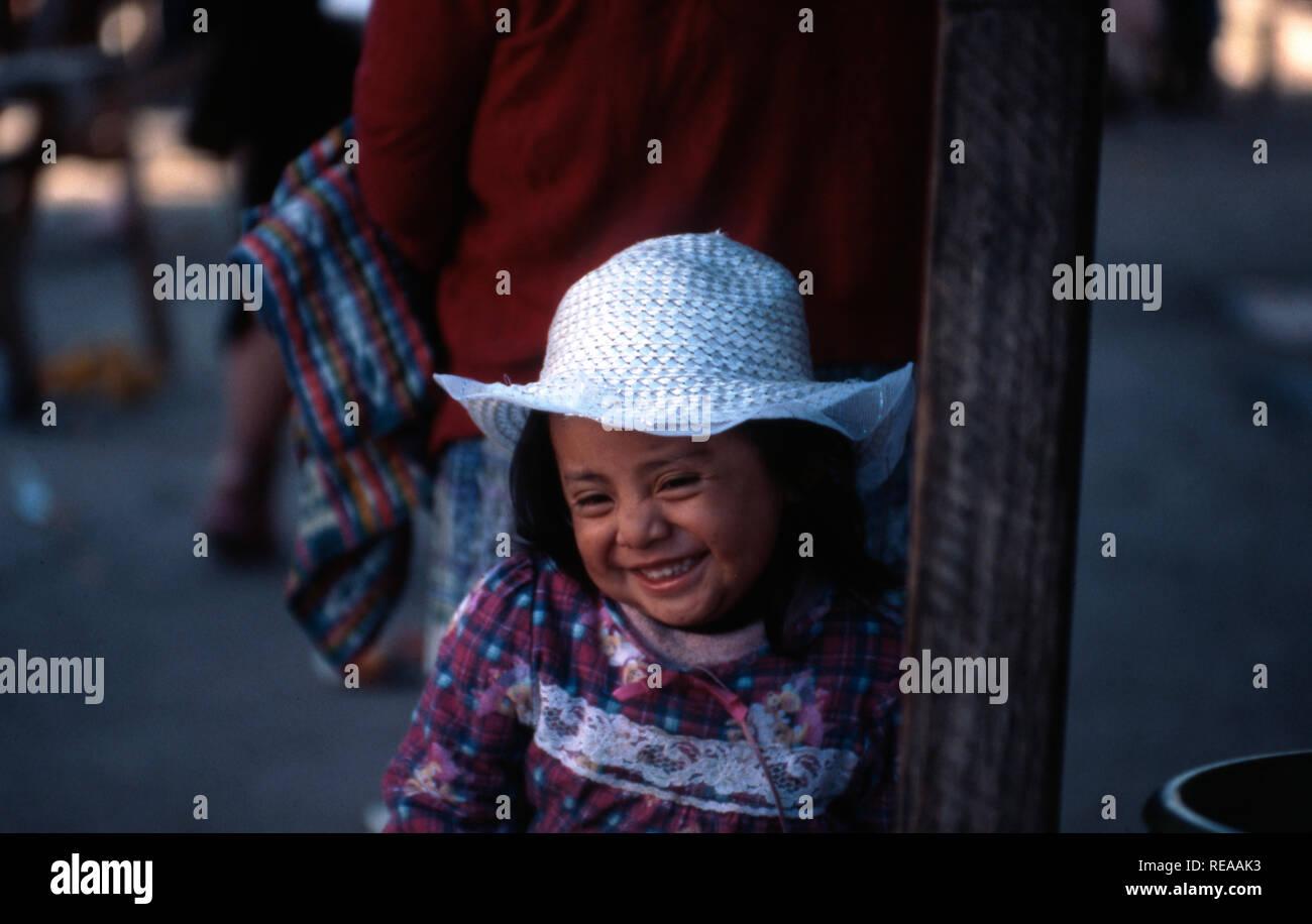 A young, indigenous Kiche Maya girl at the marketplace in Momostenango Township, Guatemala. - Stock Image