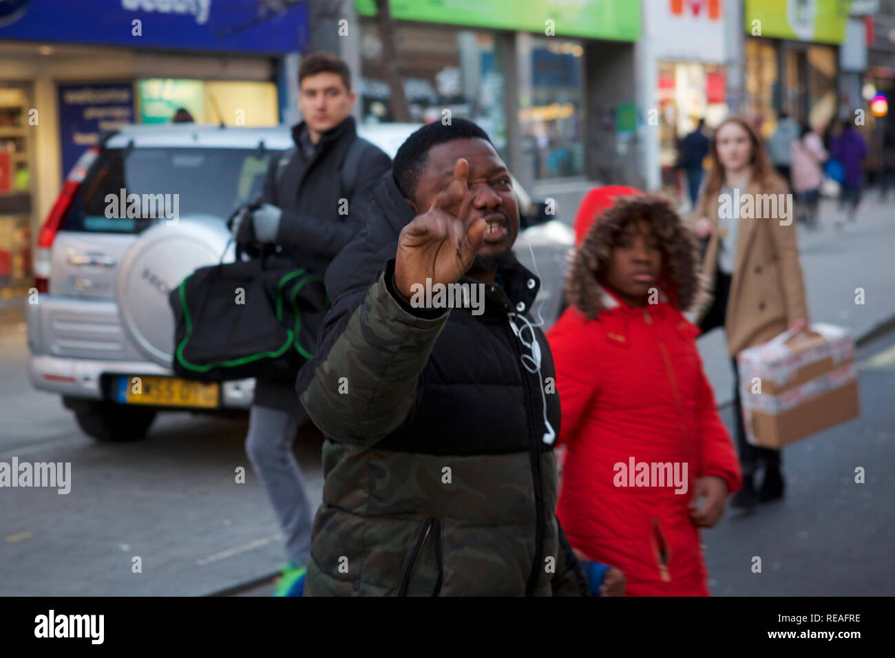 London, UK - Peckham. 20th January 2019. Violence breaks out on the streets of Peckham in south east London, between supporters of Nigerian presidential candidate Atiku Abubaker (72) and passing members of the  public who launch a tirade of abuse at the protesters before a skirmish breaks out. Credit: Iwala/Alamy Live News - Stock Image