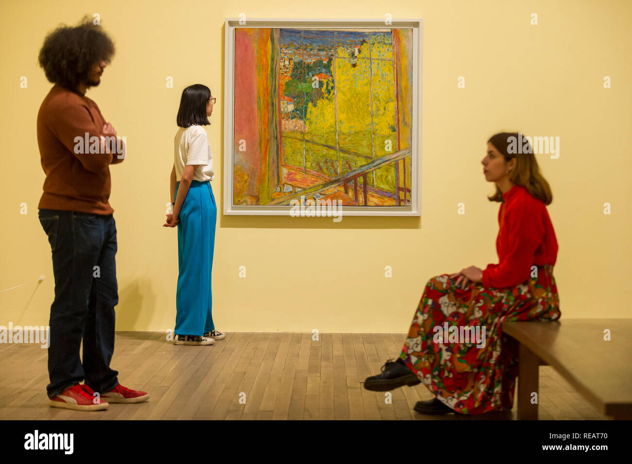 London, UK.  21 January 2019. Staff members view 'The Studio with Mimosa', 1939-46, by Pierre Bonnard.  Preview of an exhibition called 'Pierre Bonnard: The Colour of Memory' at Tate Modern.  This is the UK's first major Pierre Bonnard exhibition in 20 years bringing together around 100 of his works from around the world covering a period from 1912 to his death in 1947.  The works are on show 23 January to 6 May 2019.  Credit: Stephen Chung / Alamy Live News - Stock Image