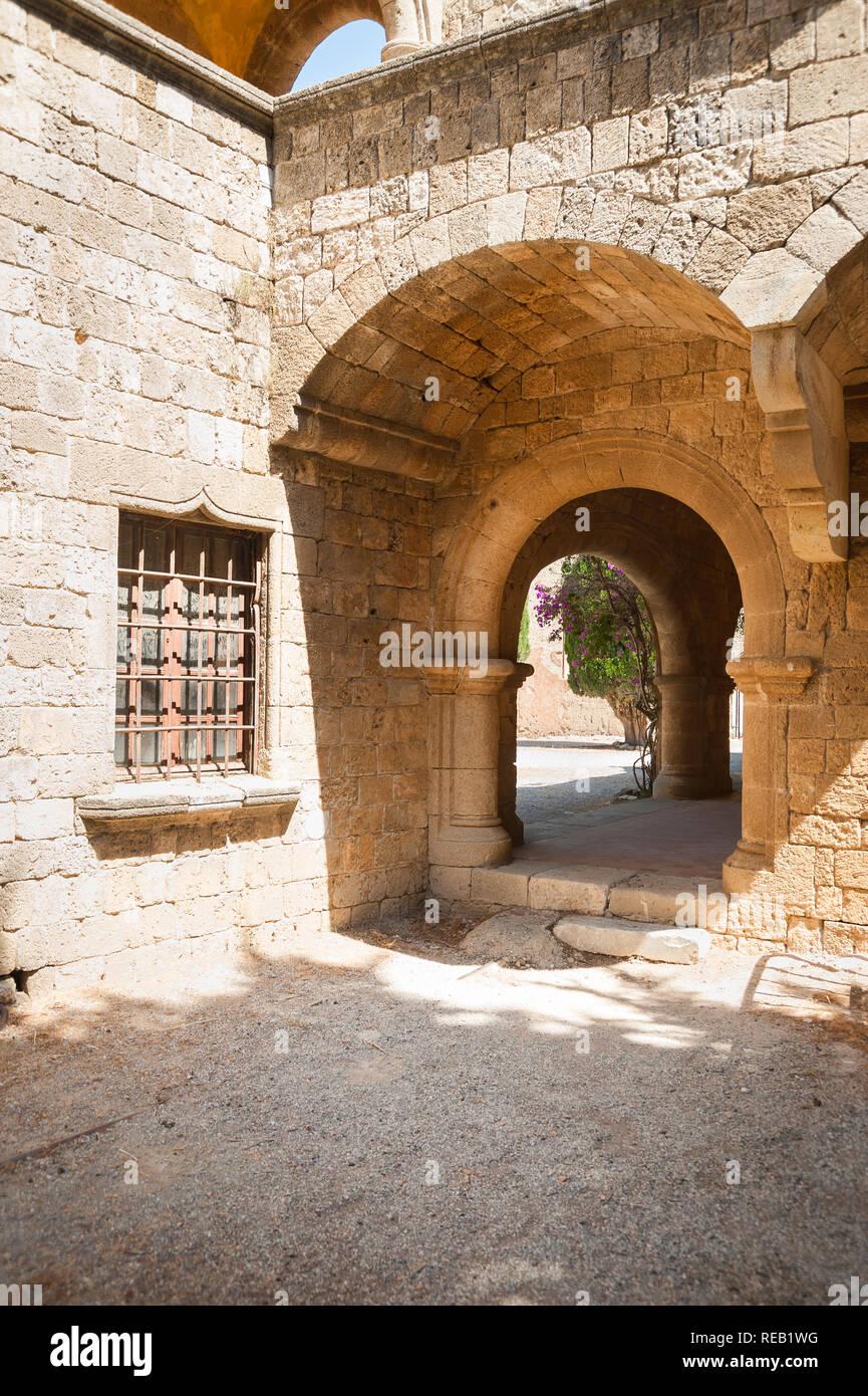 Island of Rhodes, Greece. 05/28/2018. Monastery of Filerimos, masonry colonnade running along churchyard. - Stock Image