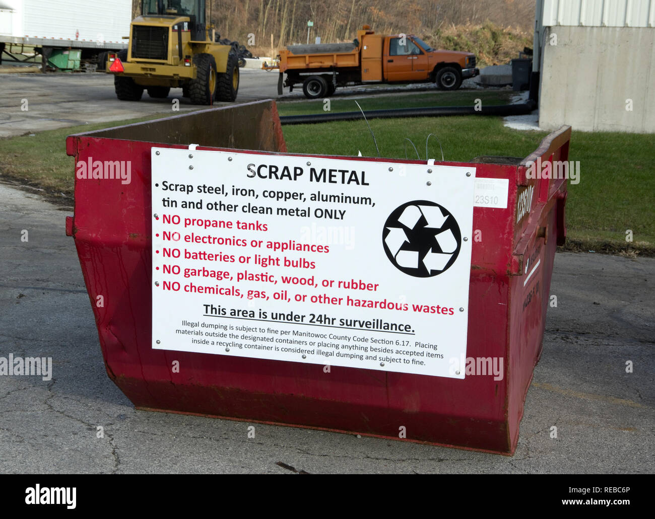 Community recycling scrap metal collection bin with sign displaying guidelines and regulations. - Stock Image