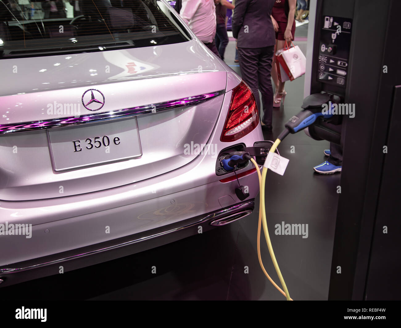 Nonthaburi, Thailand - December 4, 2018: Mercedes Benz E350e EV charging at station presented in Motor Expo 2018 - Stock Image