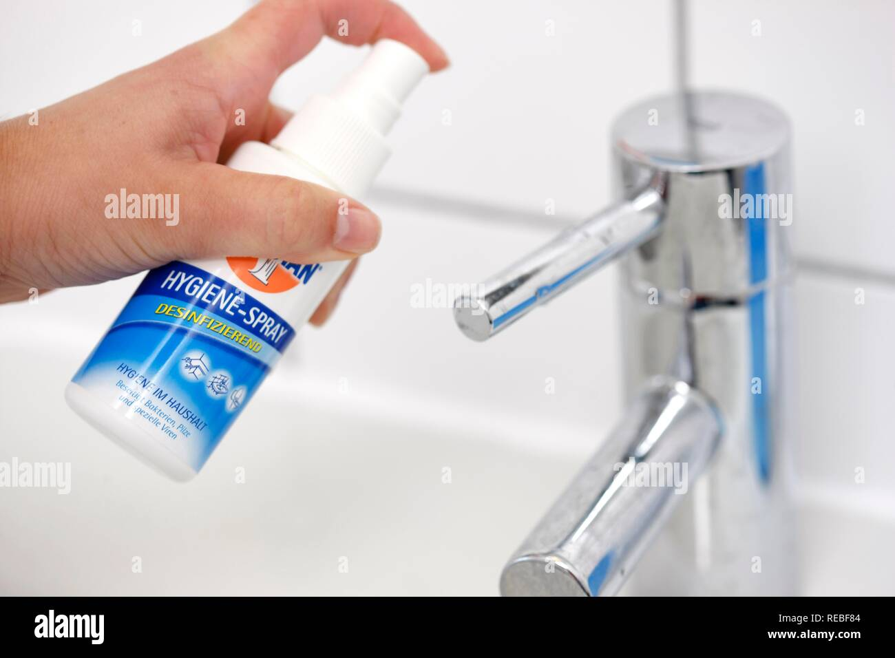 Hand basin being disinfected with a disinfectant - Stock Image