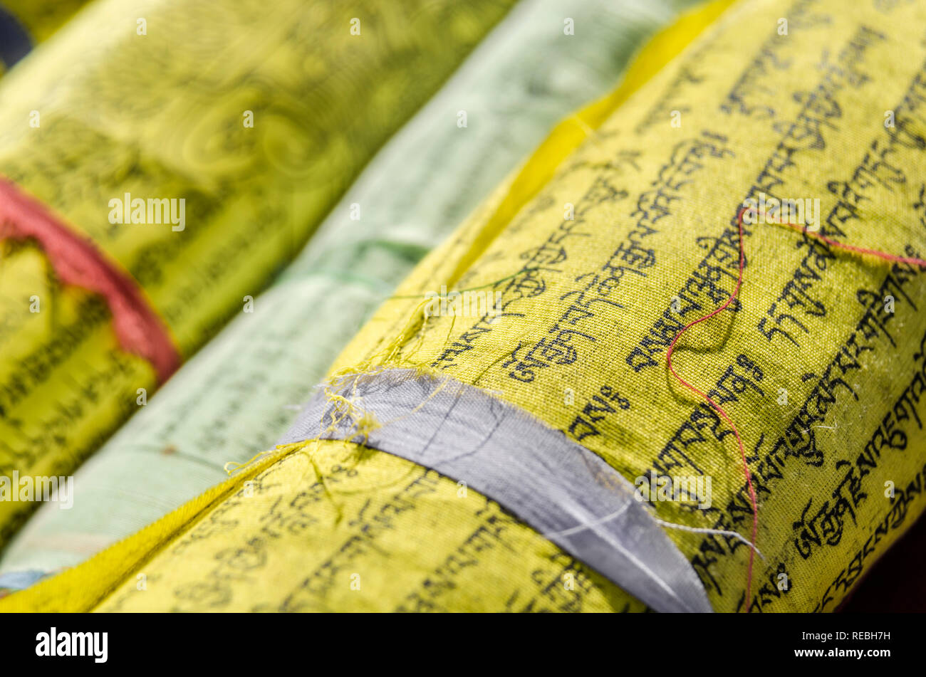 Close-up of rolled Buddhist prayer flags - Stock Image