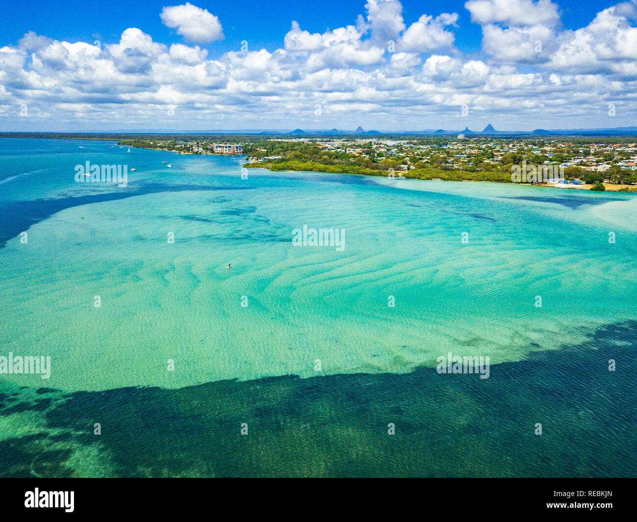 An aerial shot of the Pumicestone Channel, Golden Beach and the Glasshouse Mountains in the distance. QLD, Australia. - Stock Image