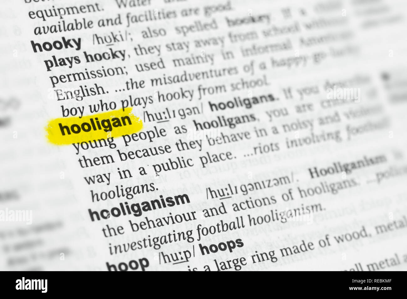 Highlighted English word 'hooligan' and its definition at the dictionary. - Stock Image