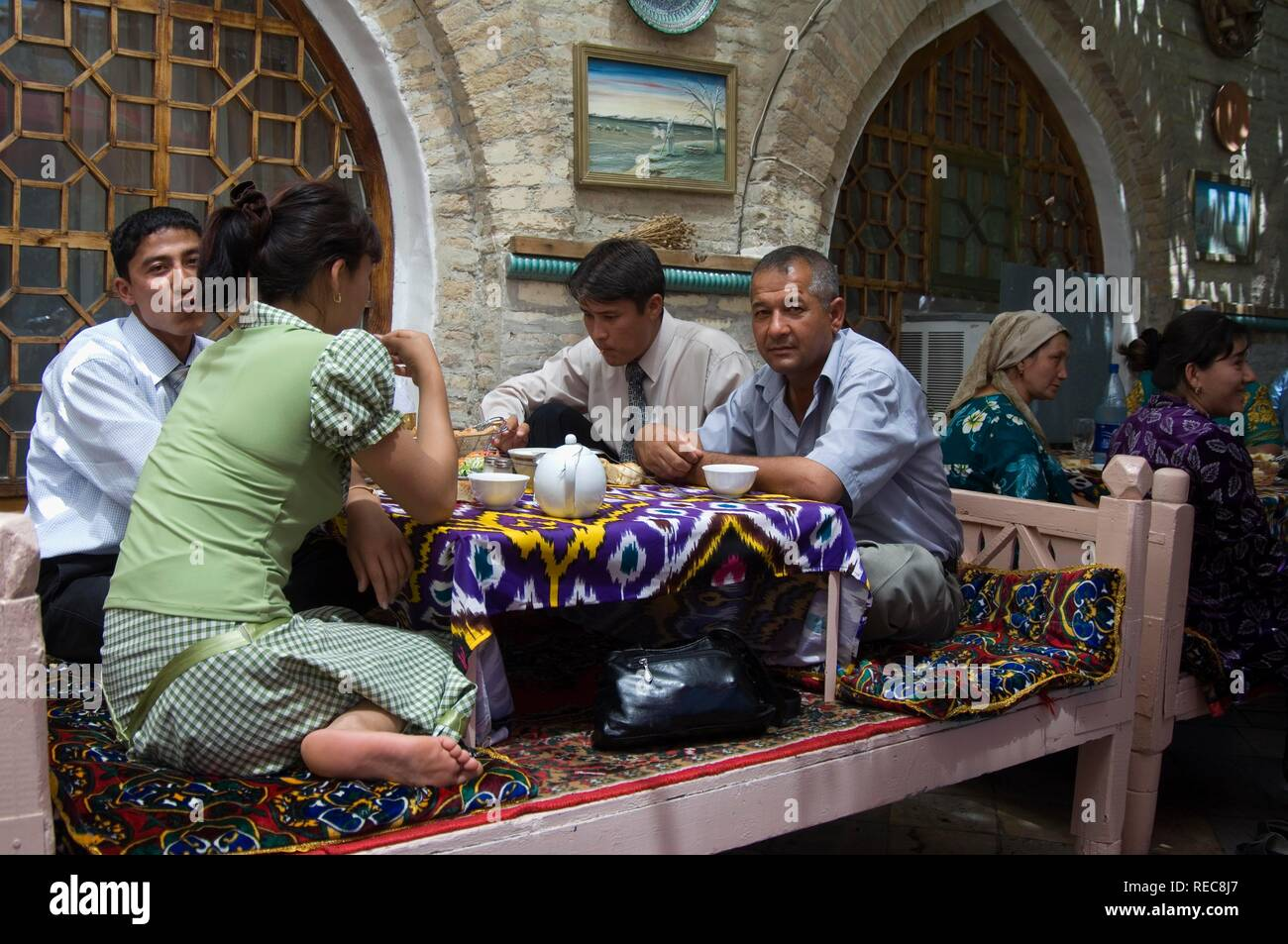 Uzbeks in a restaurant, Bukhara, Uzbekistan Stock Photo