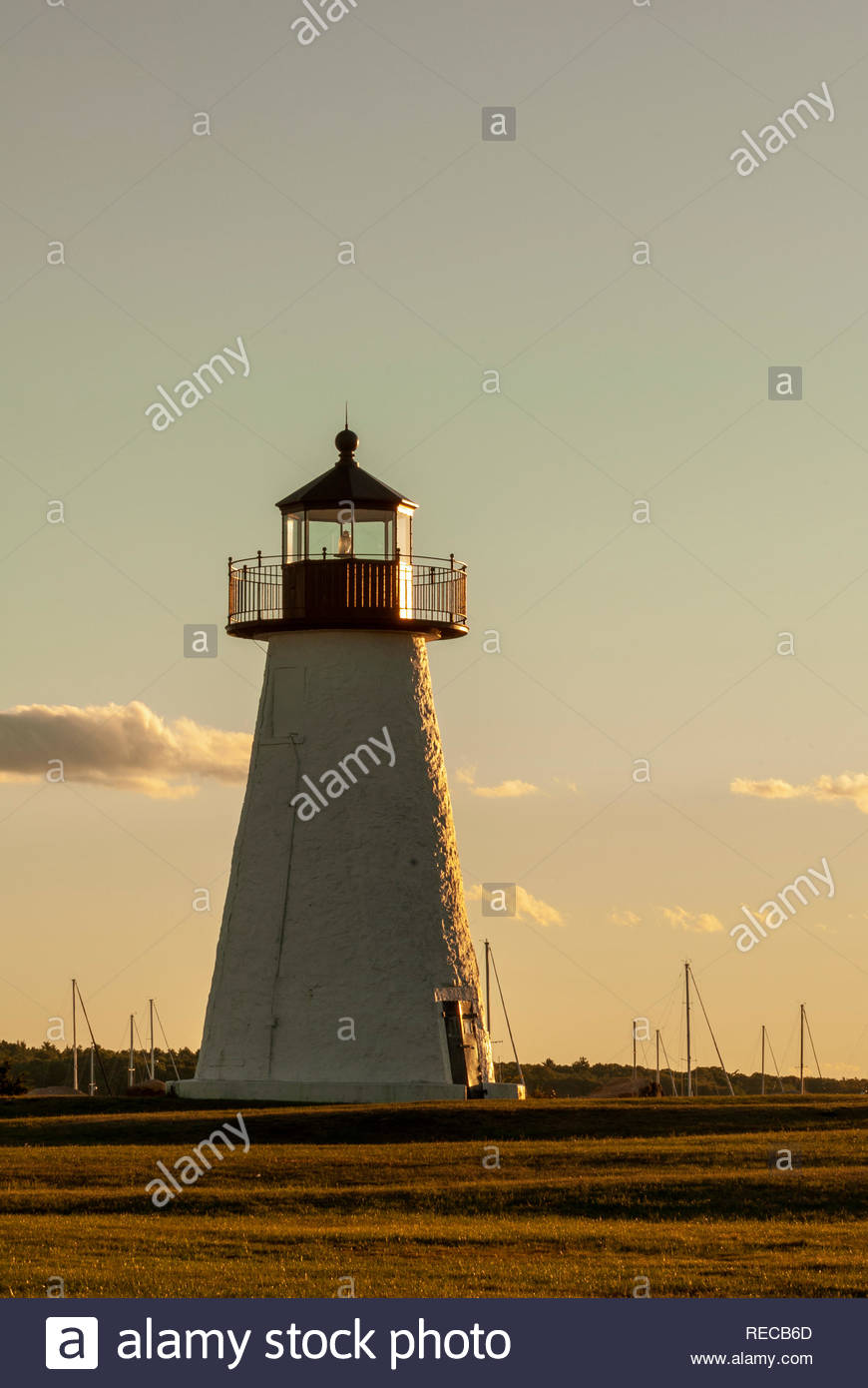 Ned's Point lighthouse sidelit by late afternoon sun Stock Photo