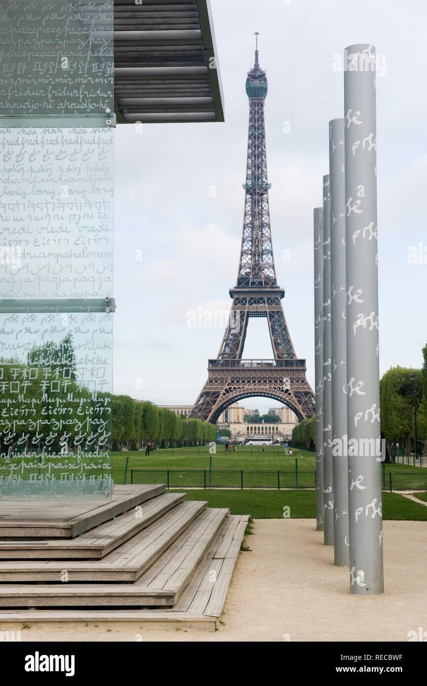 Eiffel Tower and the Mur pour la Paix, Peace Wall, sculpture by Clara Halter on the Champ de Mars, Paris, France, Europe - Stock Image