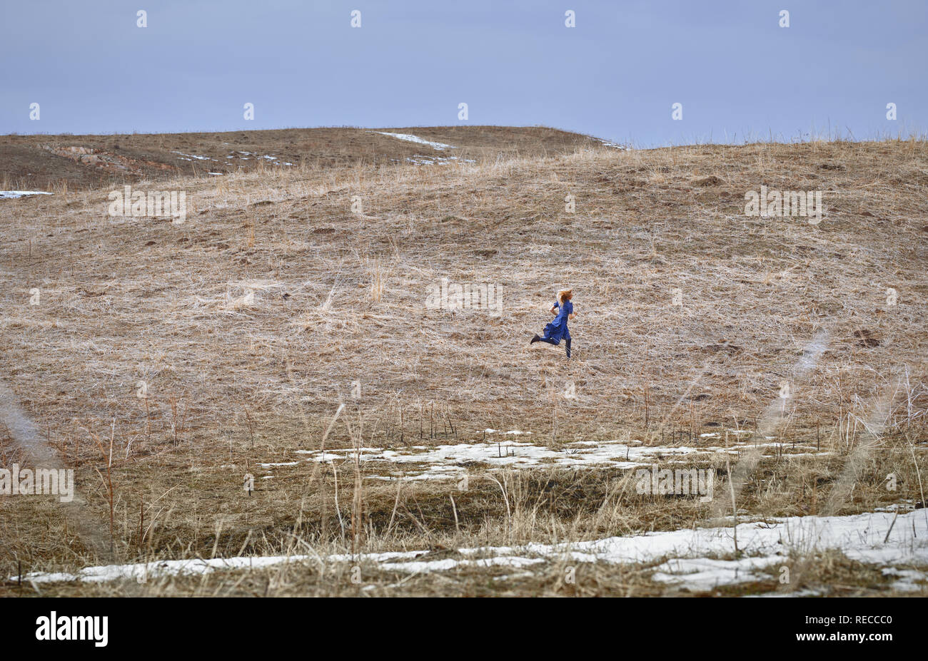 Woman running in the field Stock Photo