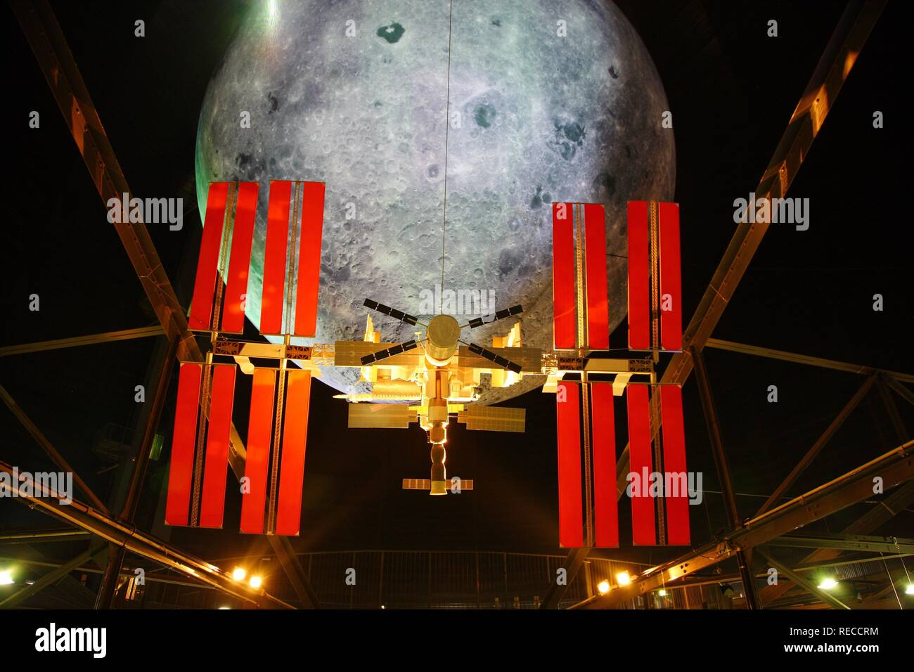 Model of the ISS, International Space Station, and the Moon, Out of this World – Wonders of the Solar System Stock Photo