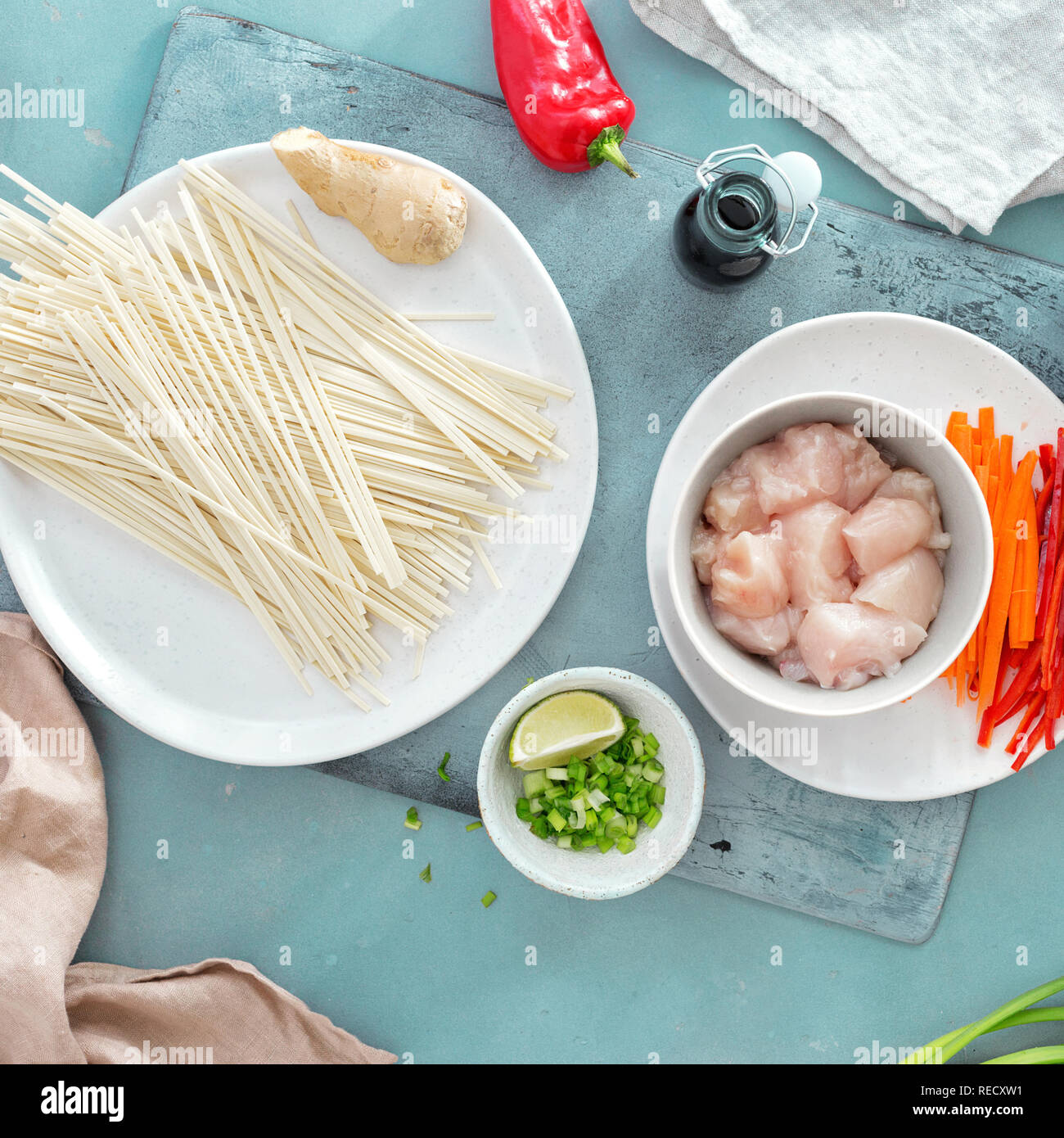 Raw ingredients cooking udon noodles with chicken meat top view Stock Photo