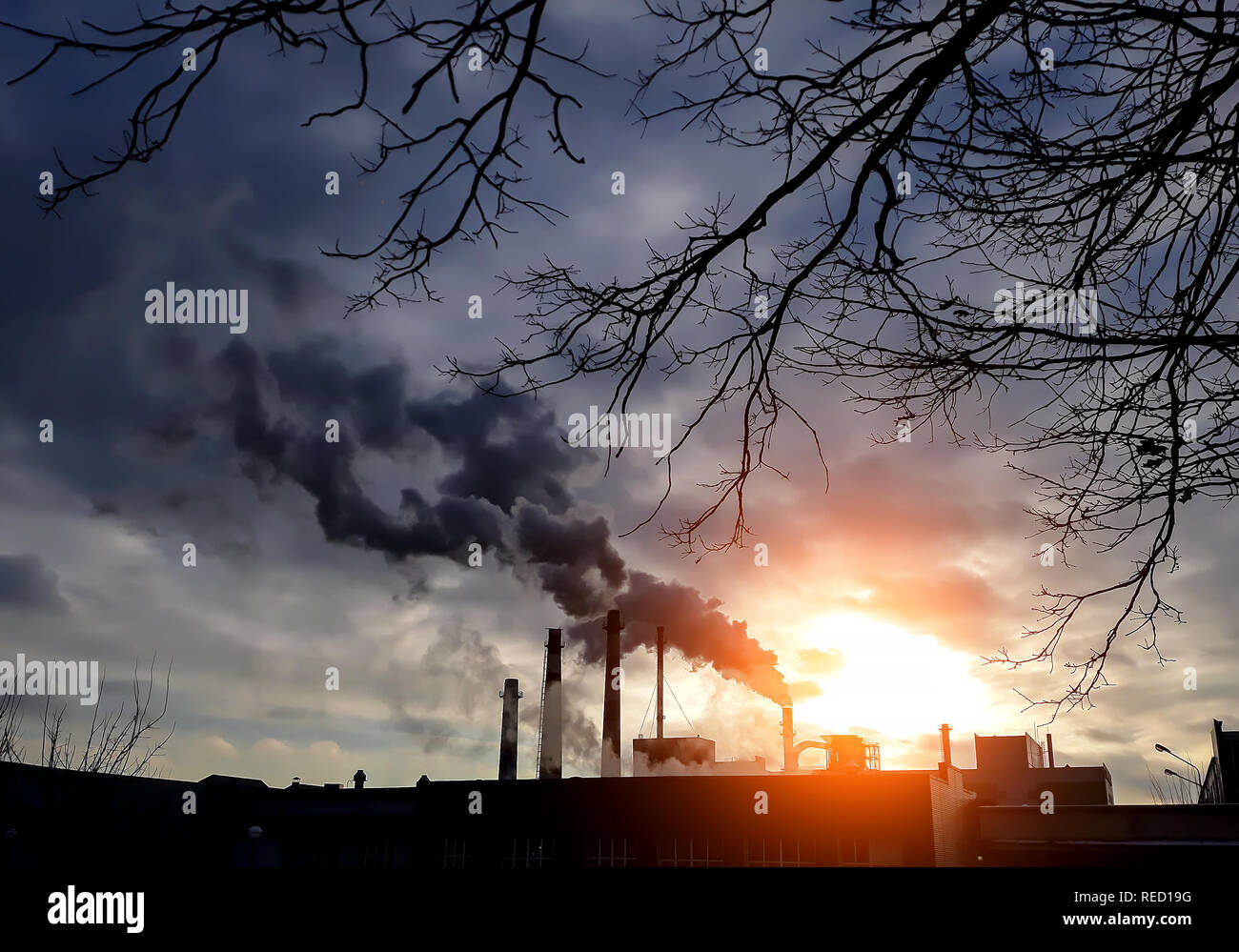 Factory chimneys with black smoke. Factory smokestacks. Air pollution. Environment pollution concept. Ecological disaster concept. - Stock Image