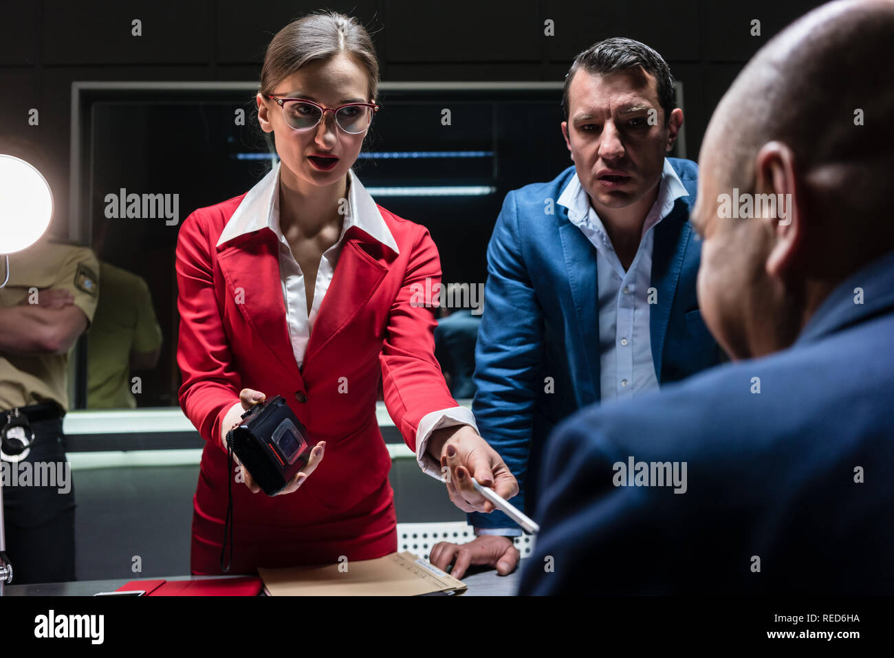 Two persuasive investigators trying to obtain a confession - Stock Image