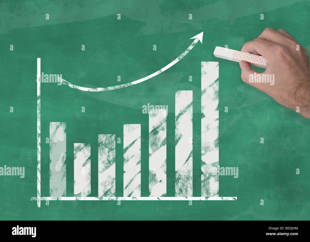 hand drawing rising curve chart on blackboard illustrating business success or rising stock prices - Stock Image