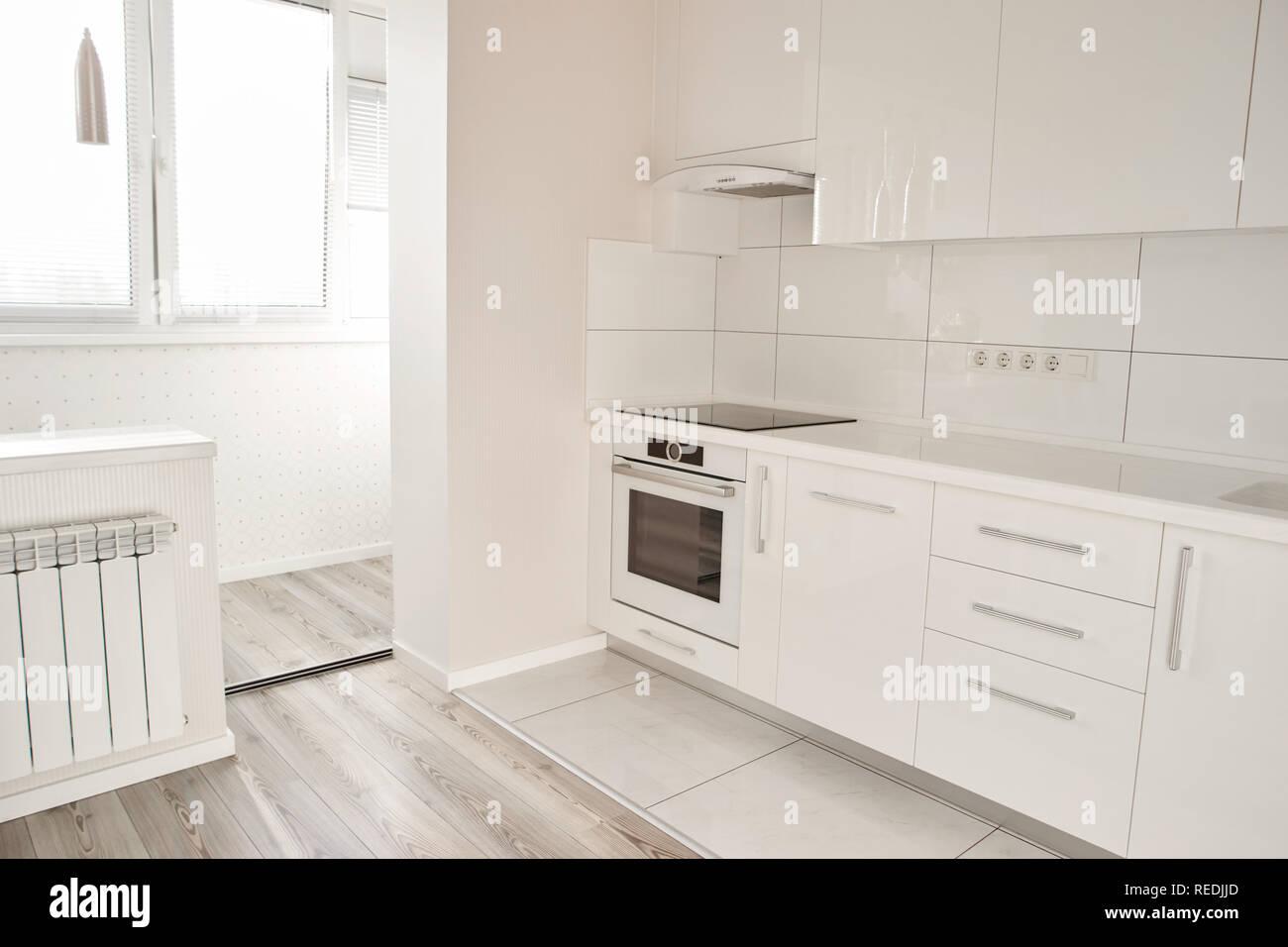 Luxury modern kitchen in new apartment. New white kitchen with ...
