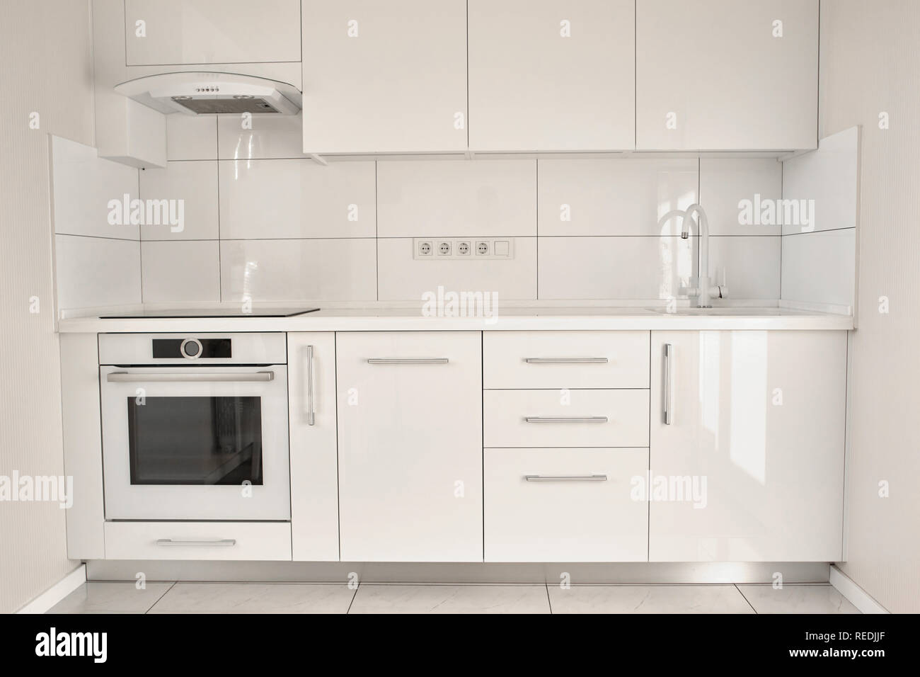 White Modern Kitchen In Contemporary Flat Interior Design Of White Modern Kitchen Minimalism In Style Stock Photo Alamy