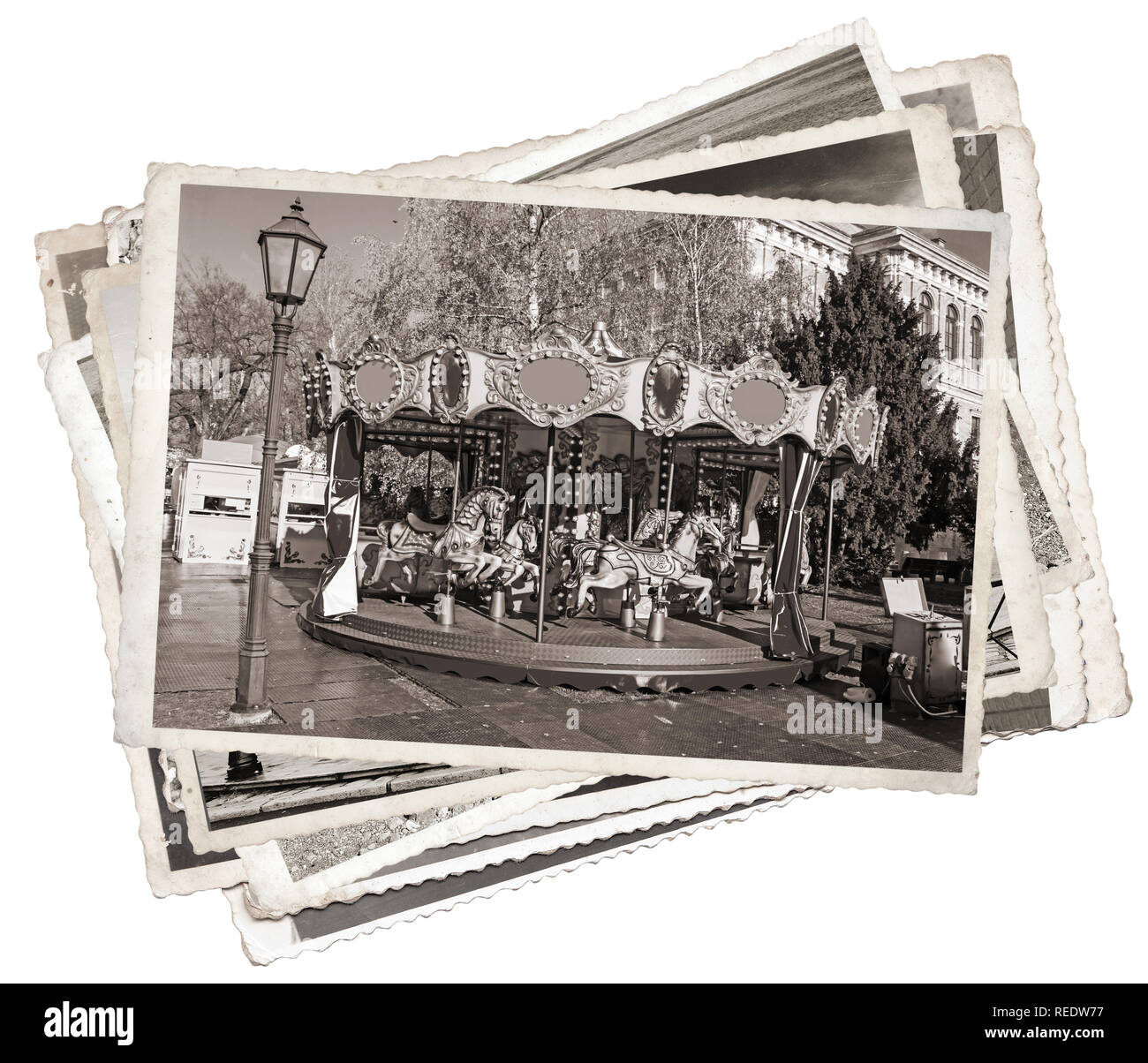Old fashioned french carousel with horses Stack of old photos Stock Photo