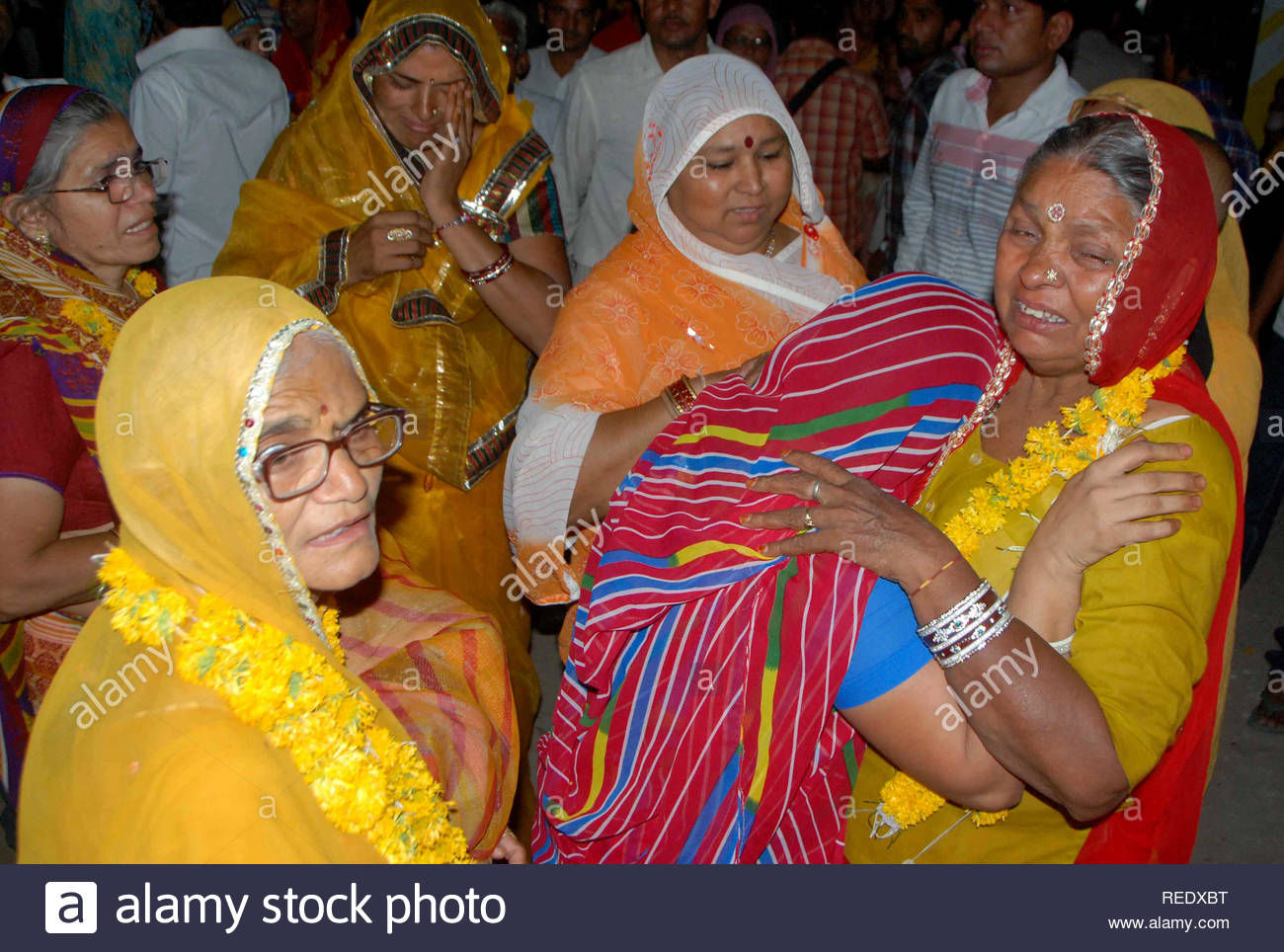 A pilgrim who was rescued and evacuated from flood-ravaged Uttarakhand, meets his relatives on arrival at Jodhpur, Rajasthan, India on June 25, 2013. (Sunil Verma) - Stock Image