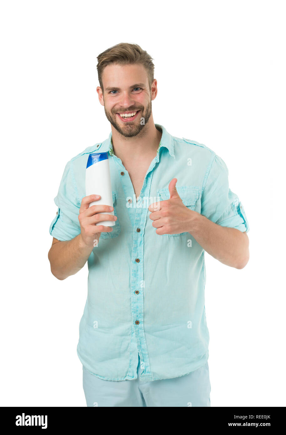 Man bearded stylish holds plastic bottle. Guy handsome care about appearance use cosmetic or hygienic product. Man show his favorite shampoo conditioner for hair. Shampoo highly recommend product. - Stock Image