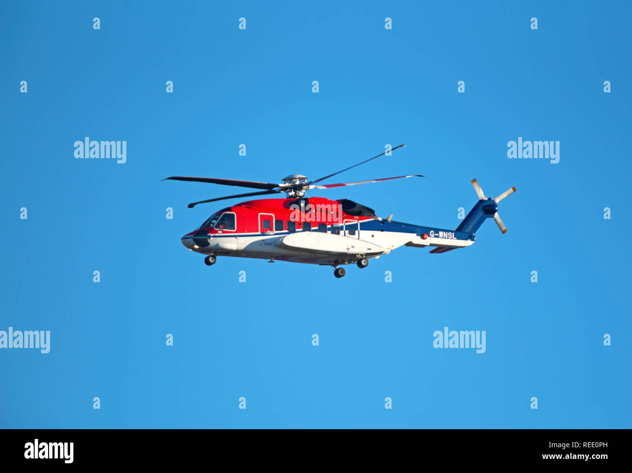 A Sikorsky S92-A helicopter from the Babcock MCS Offshore/Onshore fleet at Aberdeen arriving back at Dyce heliport from the North sea crossing. - Stock Image