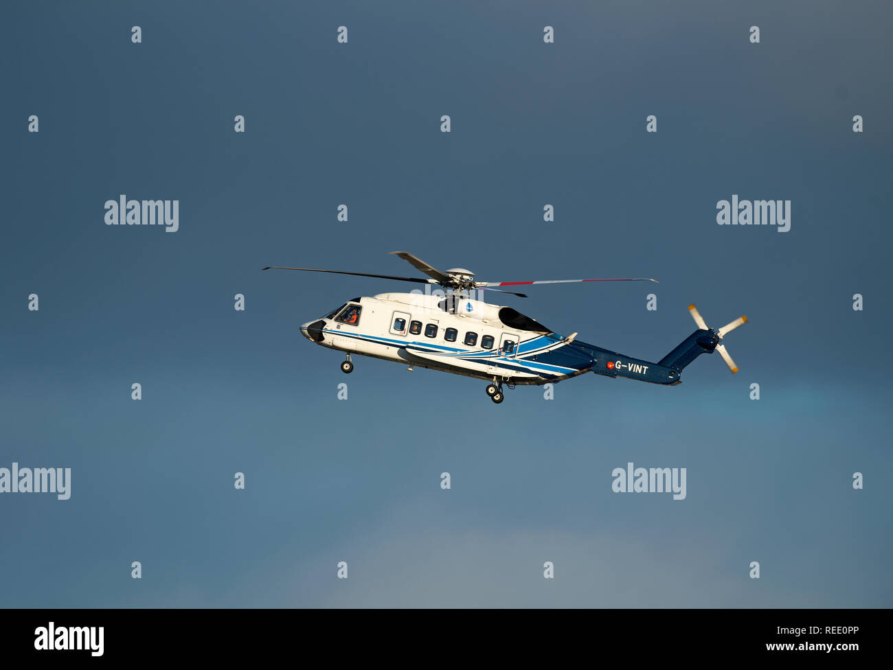 A Sikorsky S92-A helicopter from the Babcock MCS Offshore/Onshore fleet returning to Aberdeen Heliport at Dyce airport in UK. Stock Photo