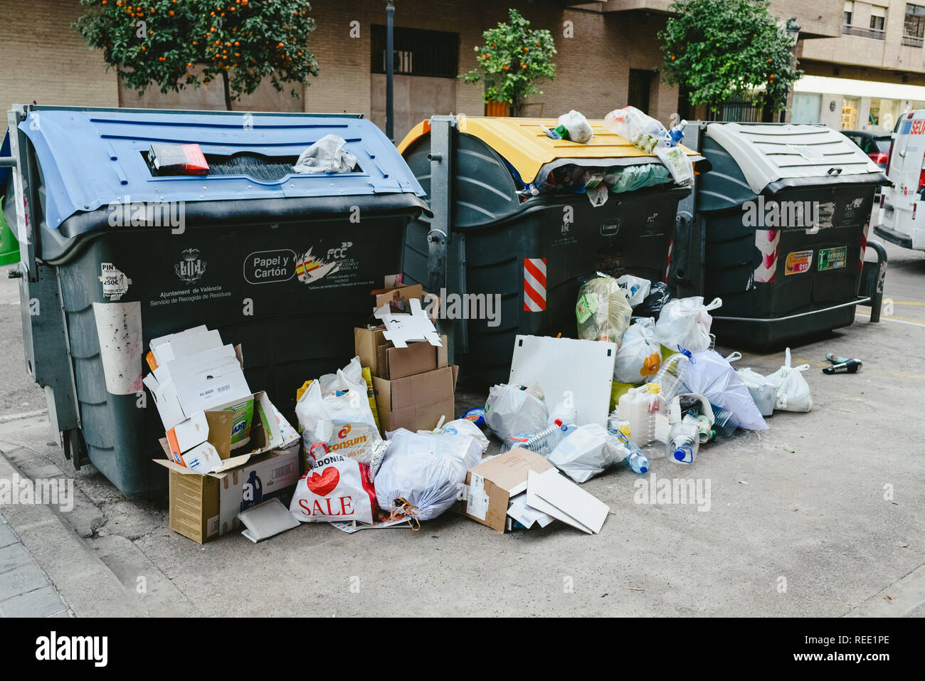 Valencia, spanish - January 14, 2019: Street garbage containers full of dirty and unhygienic garbage. - Stock Image