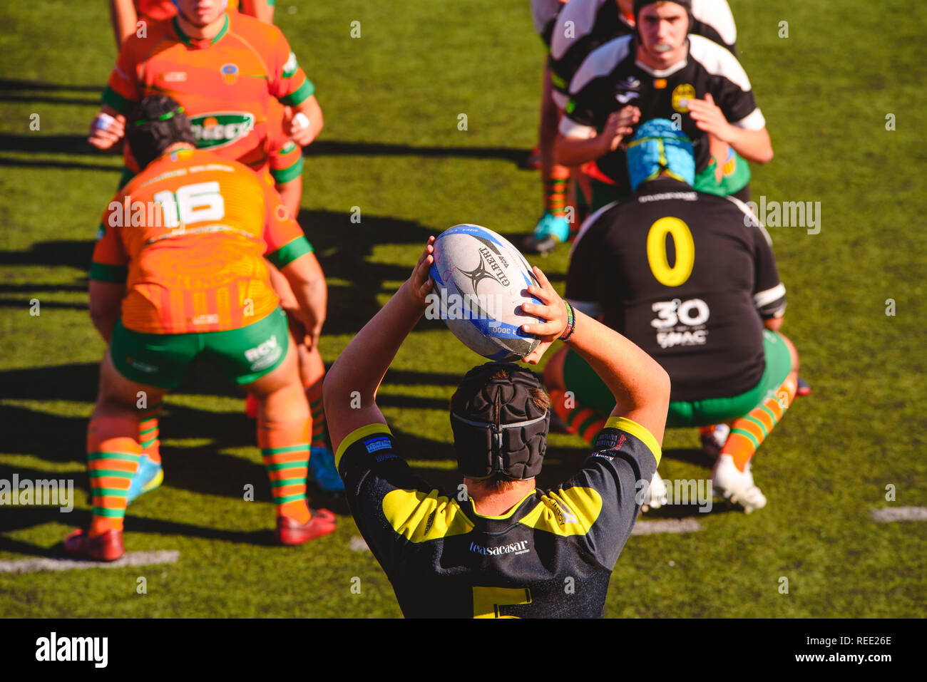 Valencia, Spain - January 19, 2019: Fight for the ball between players during an amateur rugby match. - Stock Image