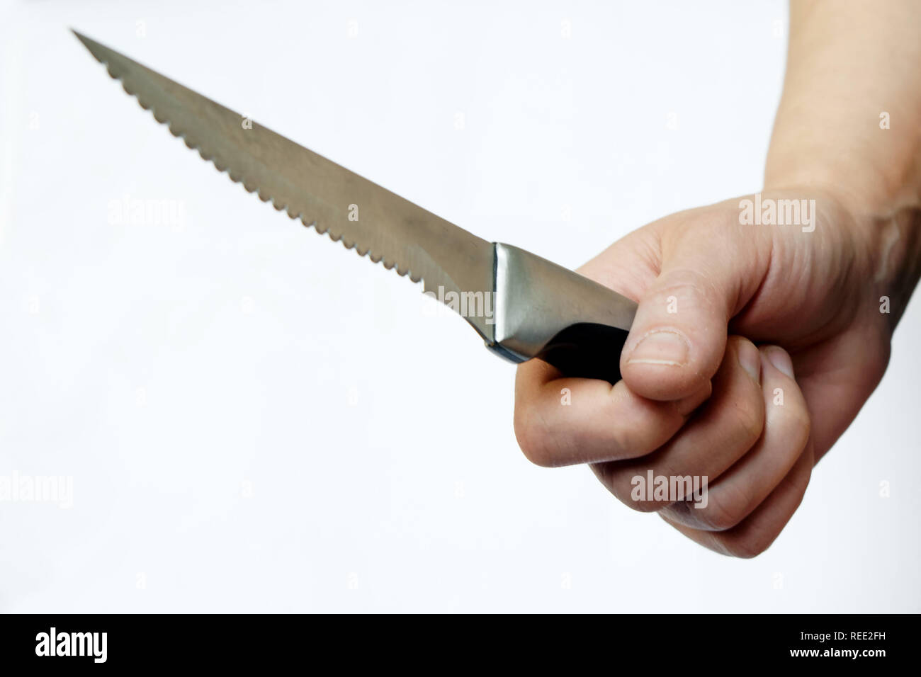 Knife In Teeth Stock Photos & Knife In Teeth Stock Images - Alamy