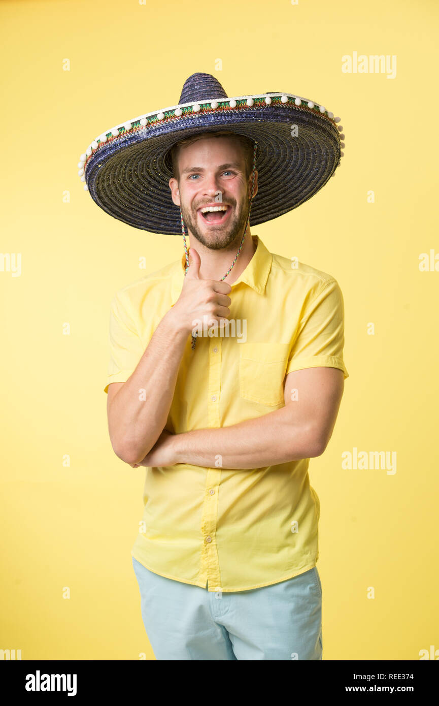066ebfb3e4f Mexico. happy man in sombrero hat mexico symbol. mexico style of happy man.  man in sombrero summer hat show thumb up. summer vacation in mexico.