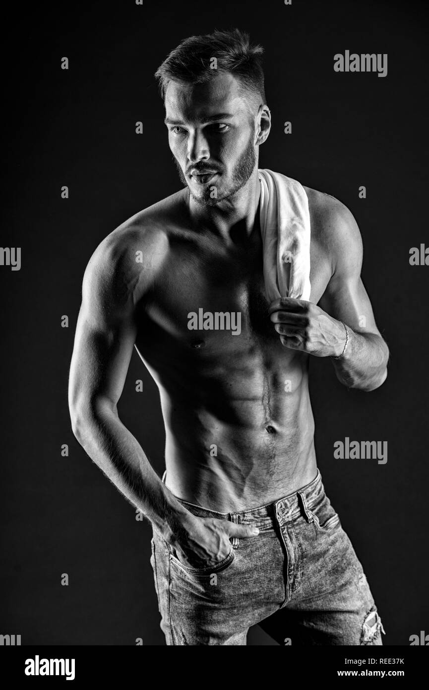 Muscle concept. Man with six pack and ab muscle. He is just the muscle. Muscle memory, black and white. - Stock Image