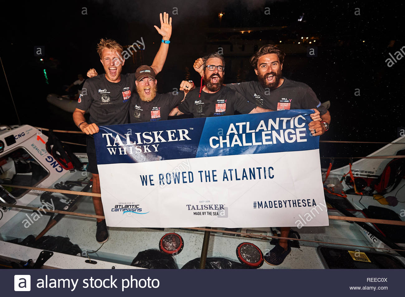 Undated handout photo issued by Talisker Whisky Challenge of Row4Victory (left to right) Duncan Roy, Glyn Sadler, Fraser Mowlem and Will Quarmby, who have survived injuries, attacks by flying fish and a near-miss with a tanker to take fifth place in a 3,000-mile trans-Atlantic rowing race. - Stock Image