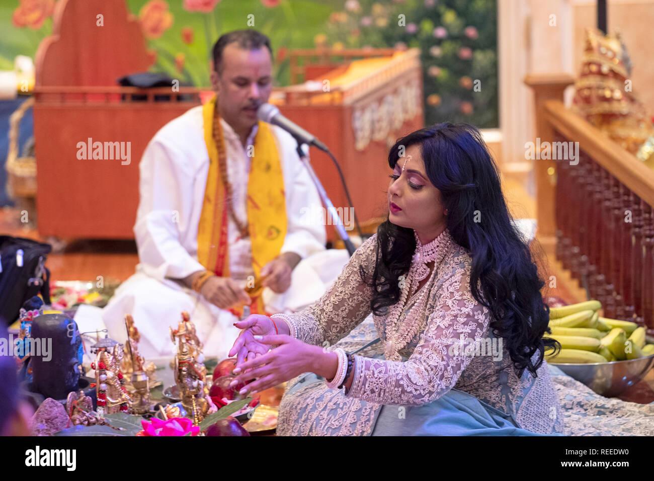 A beautiful devout Hindu worshipper celebrates her birthday by