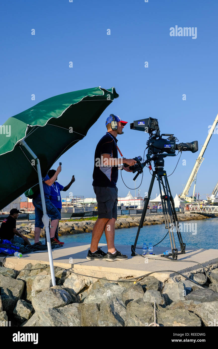 A videographer at F1H2O wearing headphones while making the ​video - Stock Image