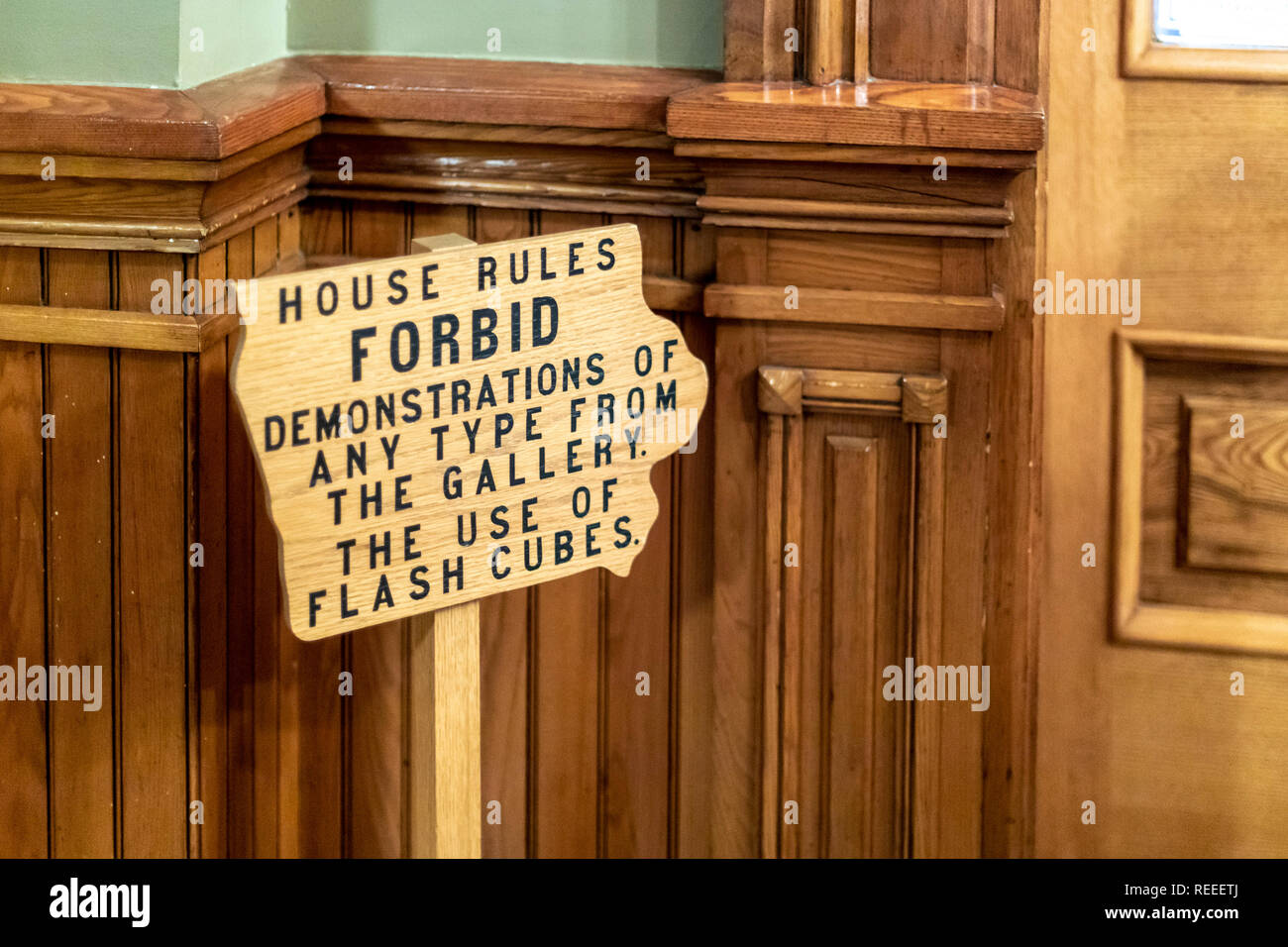 Des Moines, Iowa - A sign outside the House of Representatives visitors gallery at the Iowa state capitol building warns visitors not to hold demonstr - Stock Image