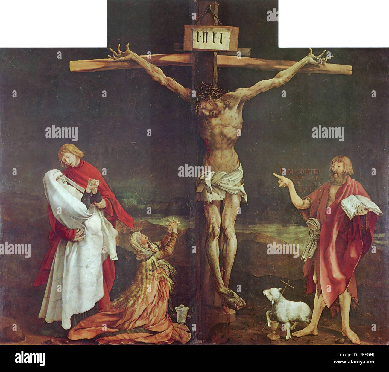 Crucifixion from the Isenheim altar by Mathias Grünewald. The Isenheim Altarpiece is an altarpiece sculpted and painted by, respectively, the Germans Nikolaus of Haguenau and Matthias Grünewald in 1512–1516. - Stock Image